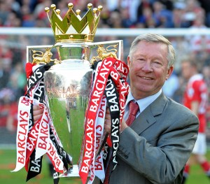 (FILES) In this file picture taken on May 22, 2011 Manchester United's Scottish manager Sir Alex Ferguson celebrates with the English Premier League trophy after their match against Blackpool at Old Trafford in Manchester, north west England. United celebrated winning the league for a 19th time beating Liverpool's long standing record. Alex Ferguson is to retire as the manager of Manchester United, the English Premier League champions announced on May 8, 2013. Ferguson, 71, has been in charge at Old Trafford for 26 years, guiding United to 13 Premier League titles and two Champions League crowns. AFP PHOTO/PAUL ELLIS FOR EDITORIAL USE ONLY Additional licence required for any commercial/promotional use or use on TV or internet (except identical online version of newspaper) of Premier League/Football League photos. Tel DataCo +44 207 2981656. Do not alter/modify photo.